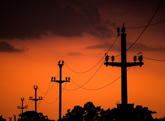 Shot of electric wires connecting with each other during evening time
