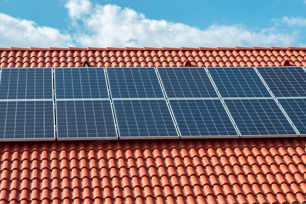 Tile roofs and solar collector, recycled energy and of blue sky