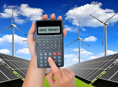 Solar panels and wind turbines.Concept of saving money.
