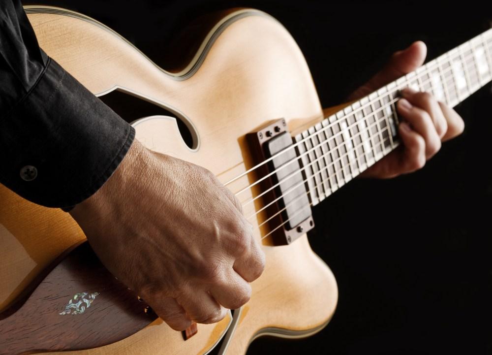 medium resolution of guitarist playing custom made jazz guitar