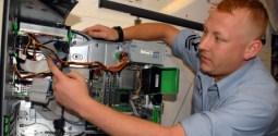 man fixing a machine