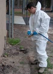 man in pest controll suit