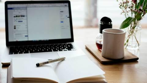 notebook, laptop computer, and tea