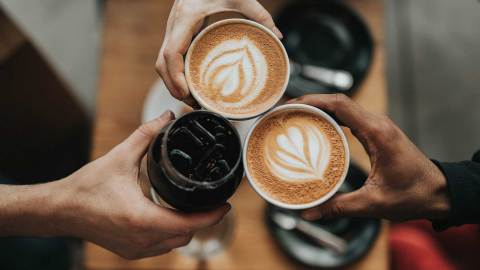 toasting with coffee drinks