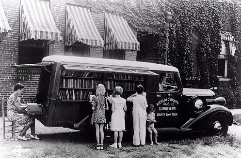 Children Reading Beside Bookmobile