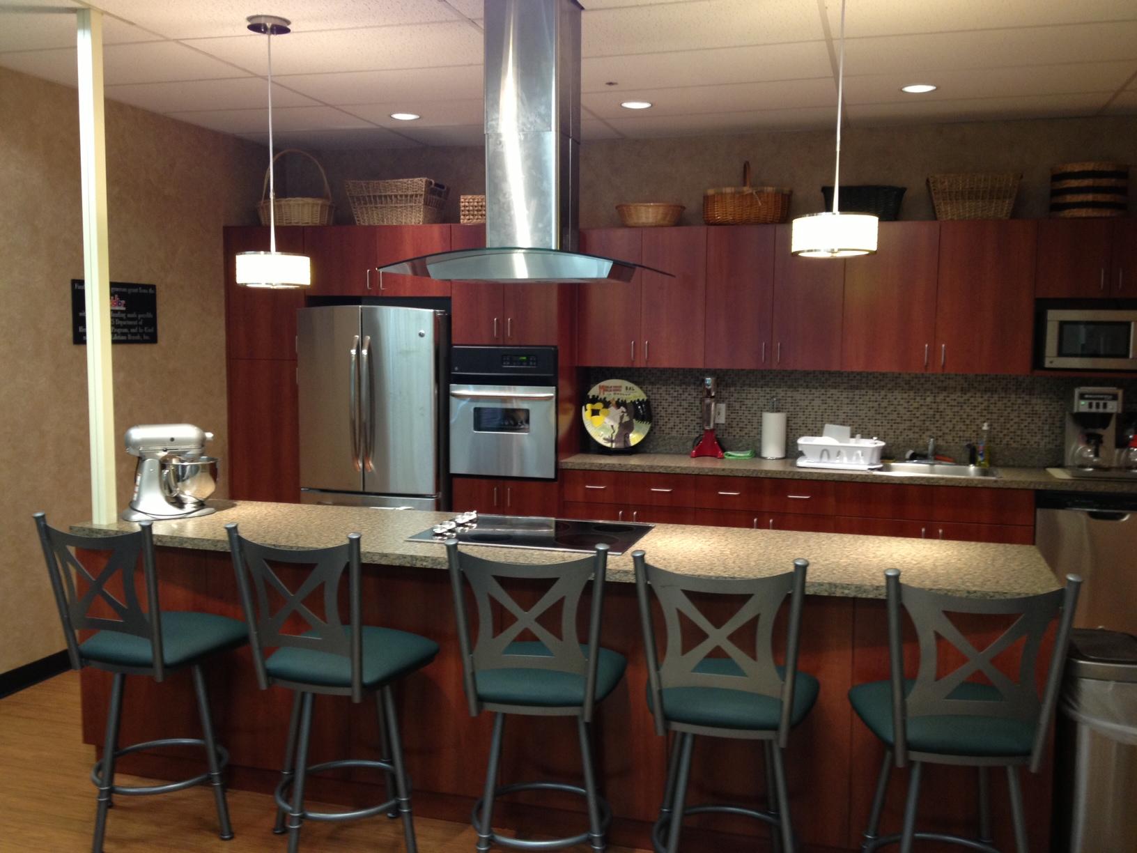 long kitchen island custom hoods cares cuts ribbon on new ddbr studio