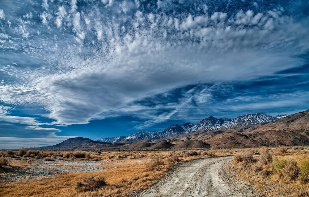 mountains road and sky