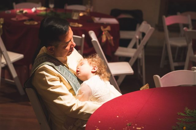 Bride's father and bride's daughter asleep after reception