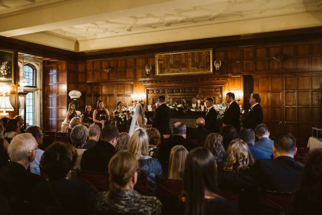 Wedding ceremony in a romantic style, dark castle room