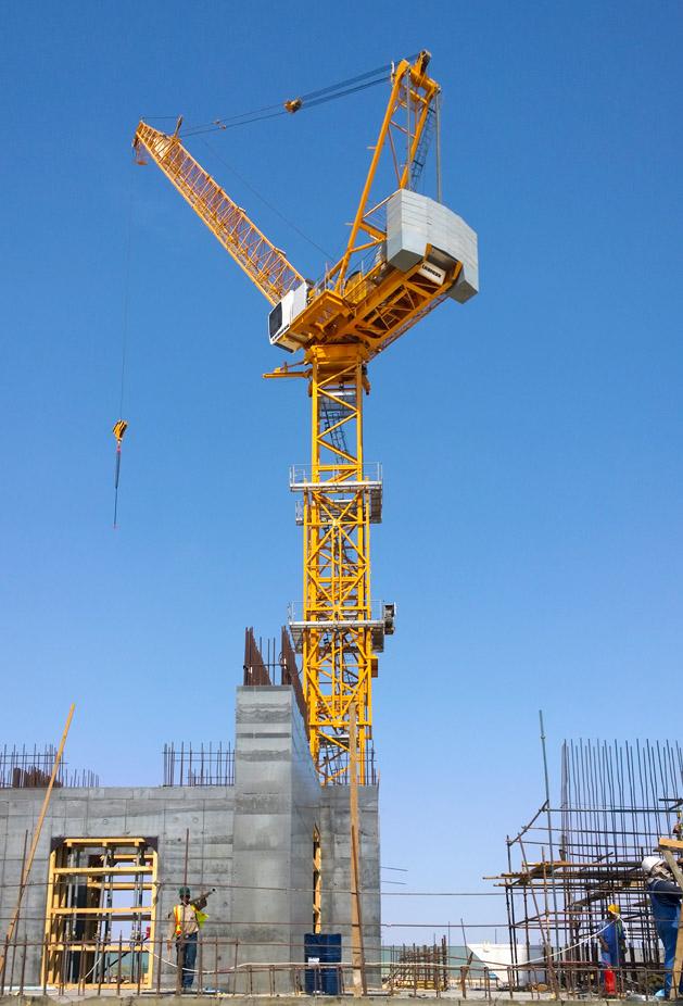 four liebherr tower cranes