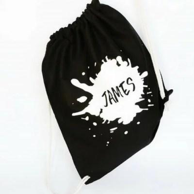 zwart witte rugzak met naam
