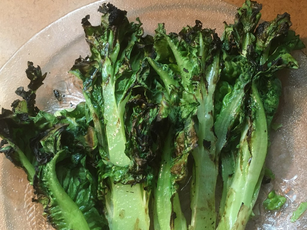 Grilled bolted buttercrunch lettuce ready to eat