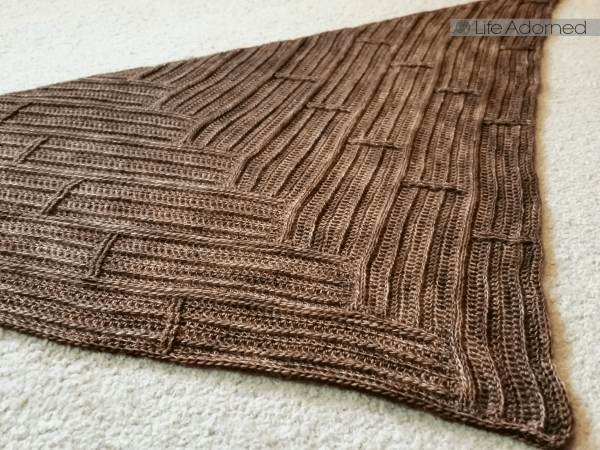 Parquet is a triangular crochet scarf with a textured wooden pattern.