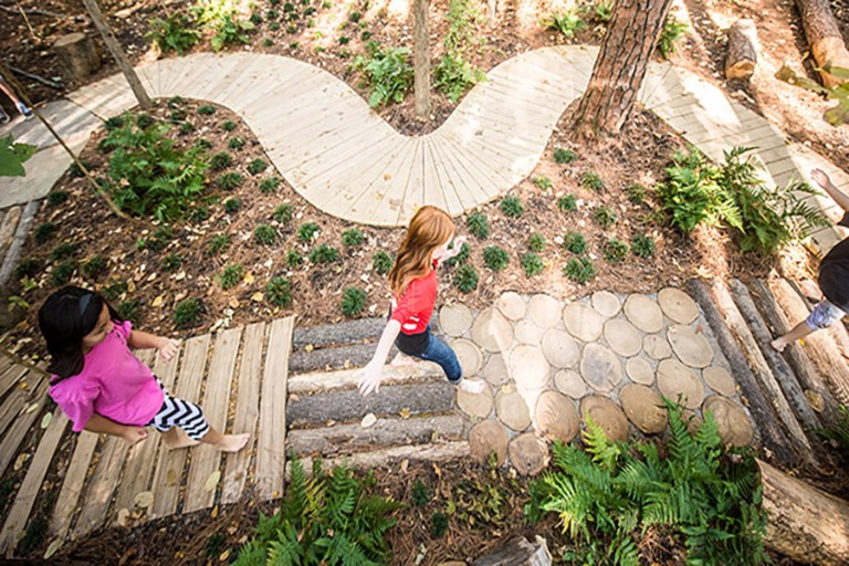 Kids playing on wooden pathway
