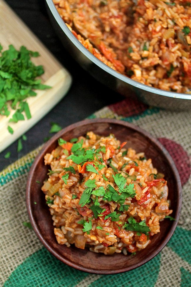 This easy vegan jambalaya is ready in under an hour - and you won't even miss the meat! Vegan, Vegetarian.