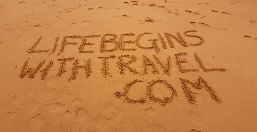 Life Begins with travel dot come written in sand - our brand new travel blog documenting our travel plans and adventures