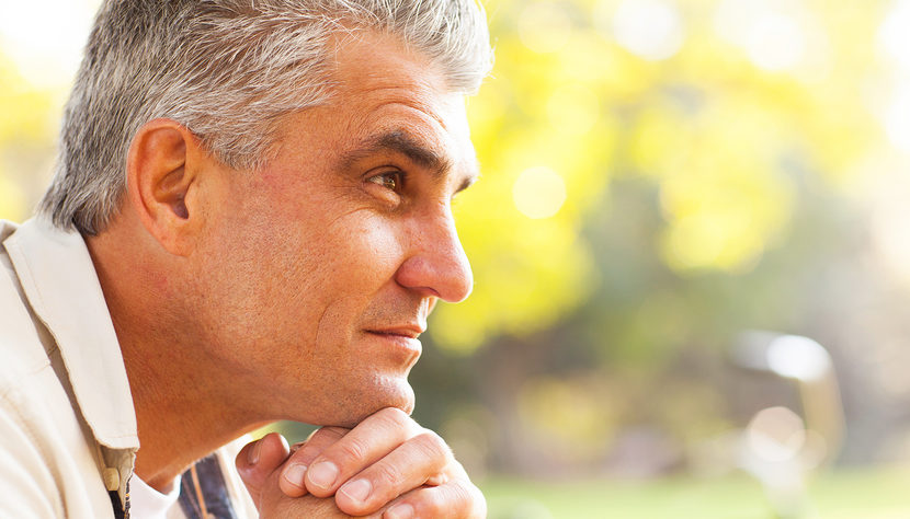 portrait of thoughtful middle aged man outdoors