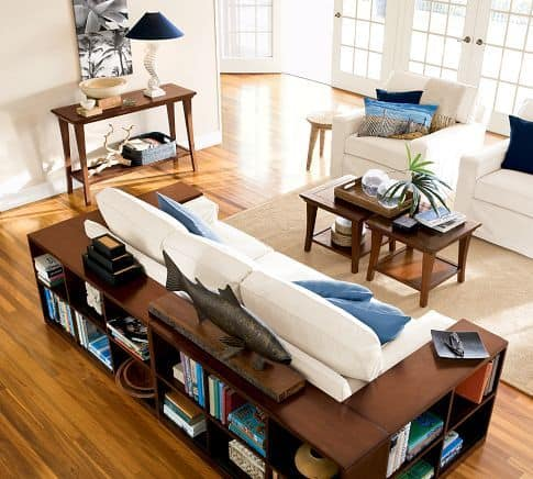 8 great DIY bookcases. Love this idea. Extra storage and instant end tables by surrounding the couch with low bookcases.