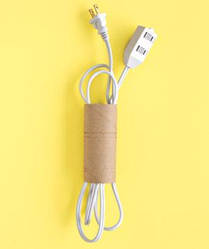 Use a toilet paper tube to keep cords organized. Hate to have to open a drawer and sort through a tangled mass of cords to find that specific one you need? Here are 5 ways to keep cords organized!