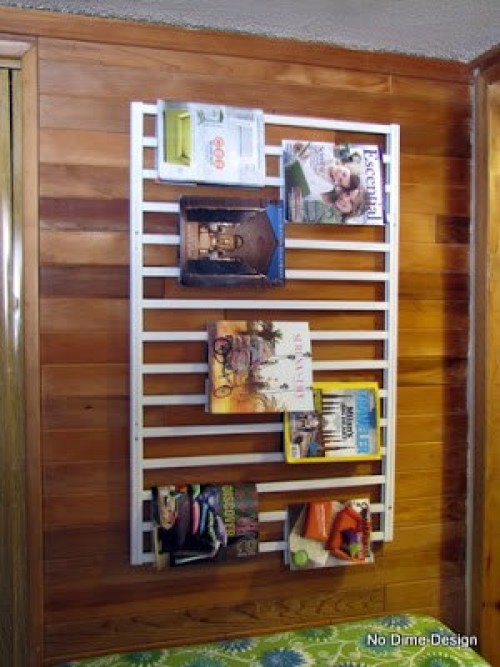 10 ways to repurpose a baby crib - Make a magazine rack with a crib rail hung on its side.