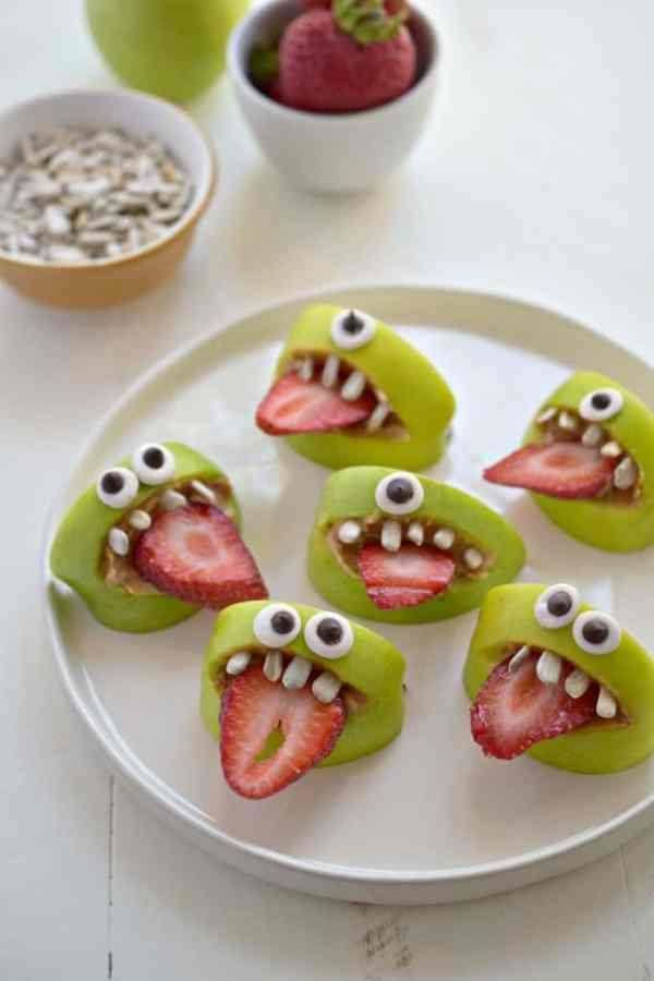 10 fun school snacks kids will gobble up! Apple mouths made with sugar eyes, strawberry slice tongues and sunflower seed teeth!