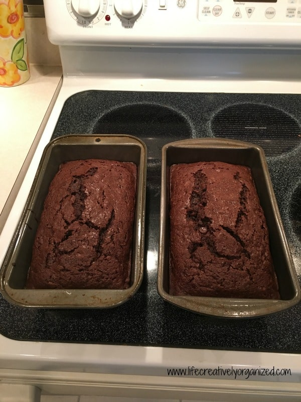 How about using some of that bumper crop of zucchini for a decadent double chocolate zucchini bread? Yummy finished loaves.