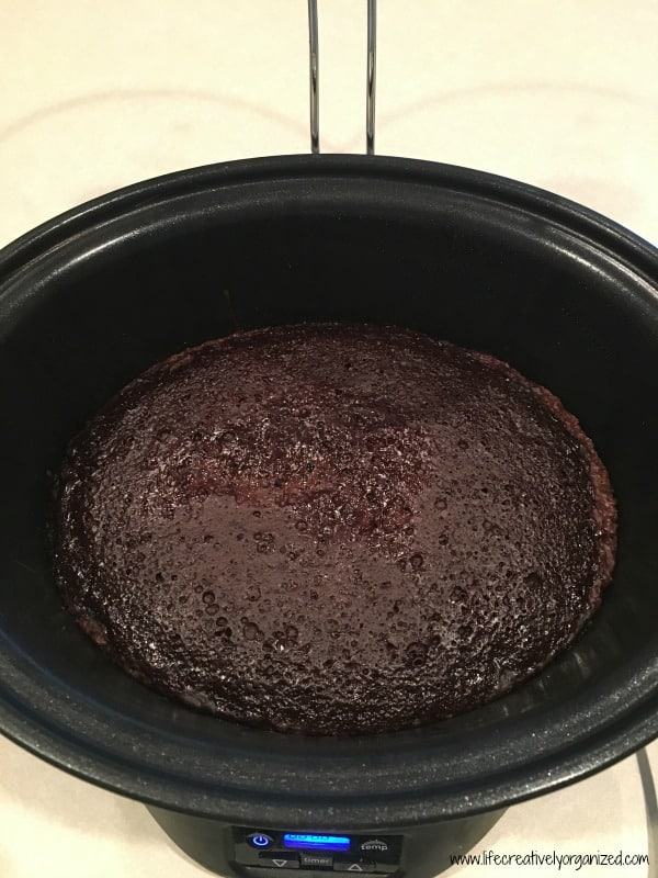 This decadent crock pot lava cake combines the best of moist chocolate cake and creamy pudding in a sinfully rich dessert, straight from the crock pot!