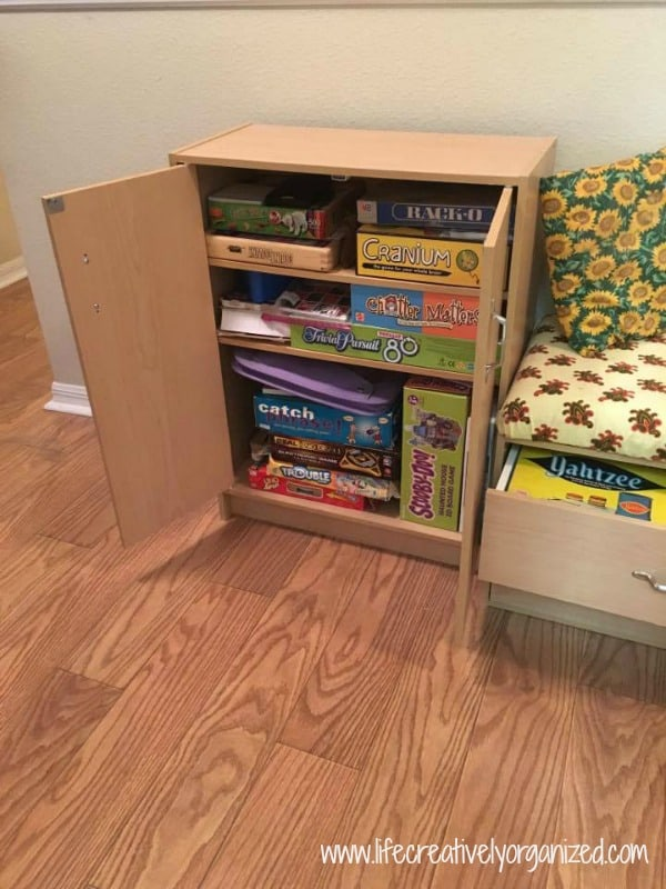With 3 kids, we have a lot of board games. Here's how we used a wide hallway for game storage that easily holds all of our games and has seating in it, too.