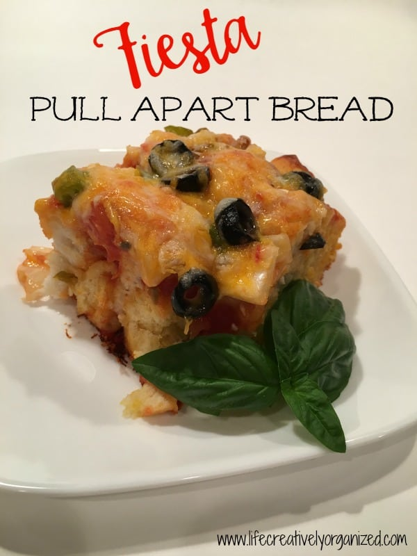 There are endless flavors of pull apart bread, but my family and friends really like this savory Tex-Mex version. We call it fiesta pull apart bread.