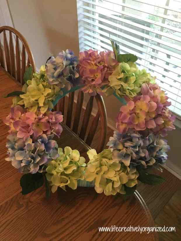 Gorgeous hydrangeas! They really brighten up a yard after a long gray winter. Freshen up your front door with an easy spring hydrangea wreath!