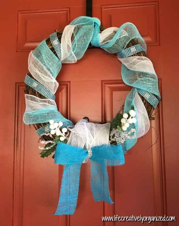 Now that the Christmas decorations are down, is your front door looking a little blah? Brighten it up with this inexpensive frosty blue and white DIY winter wreath! Do your kiddos love Frozen? I'm sure Elsa and Anna would love this wintry wreath, too!
