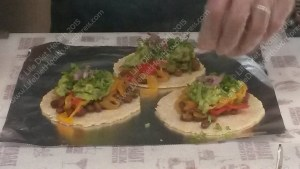 Putting the finishing touches on the tacos... good job we went before the queue arrived!