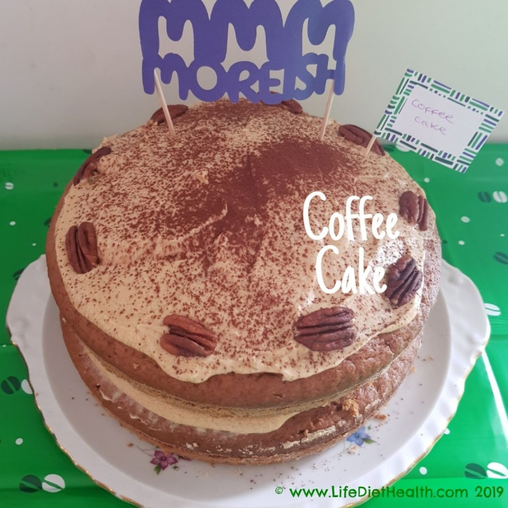 Coffee cake on a plate with MMM Moreish banner on top.