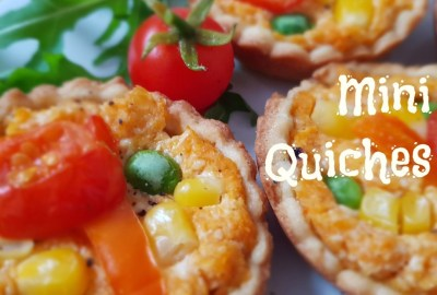 Three mini vegetable quiches with rocket & tomato
