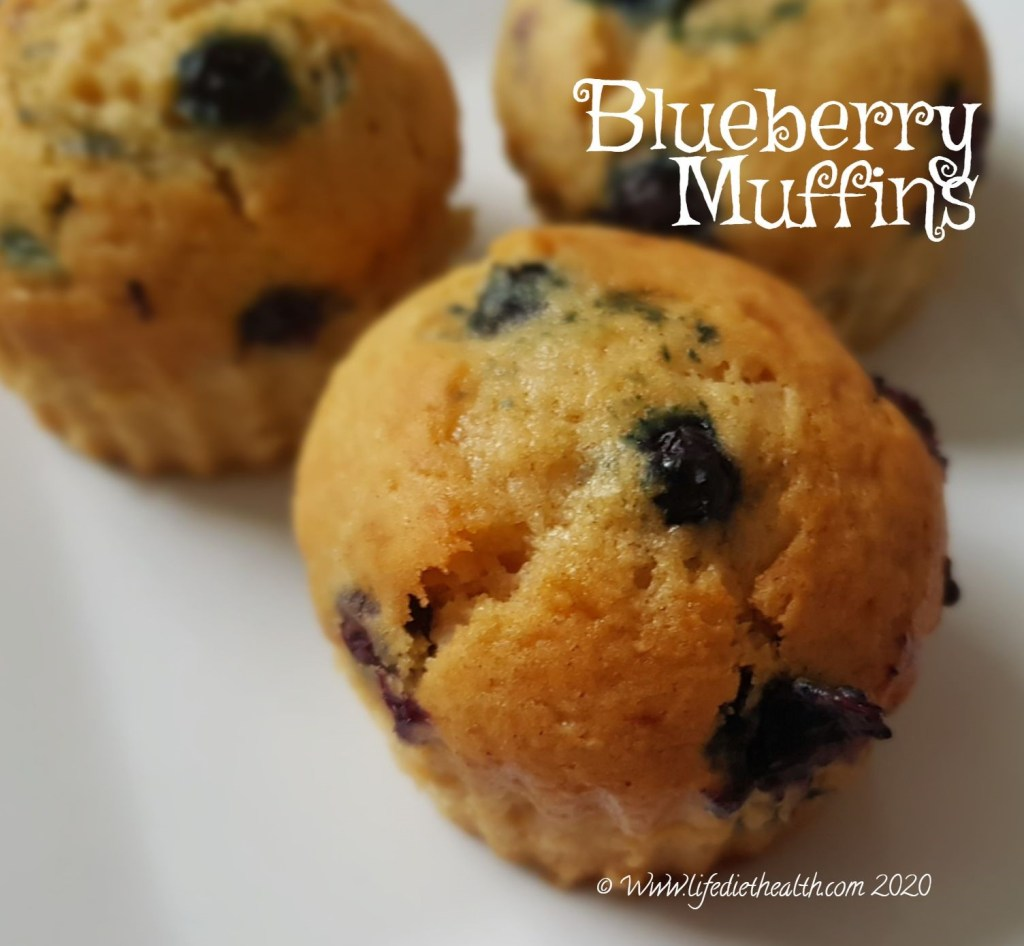 White plate with three blueberry muffins.
