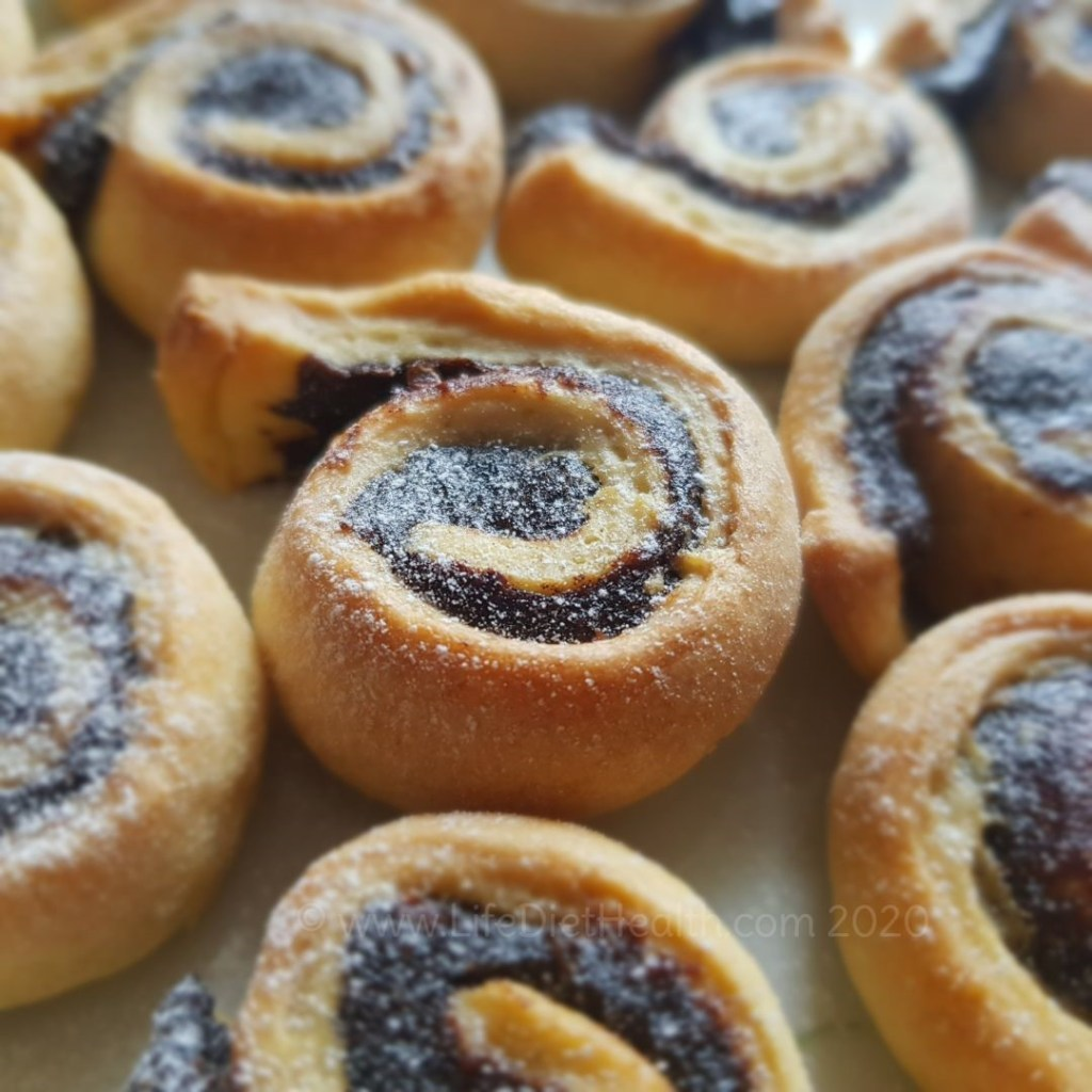 Close up of date spiral pastries dusted with icing sugar
