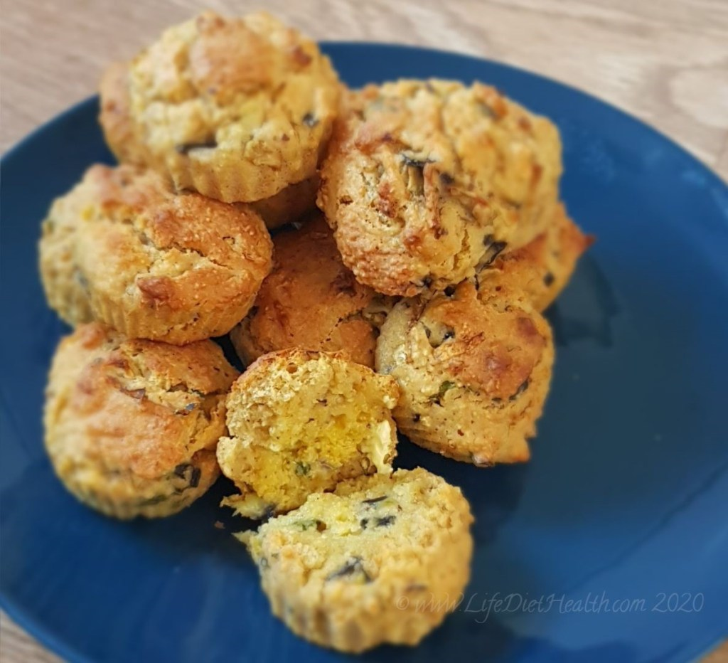 Stack of savoury muffins on a navy blue plate