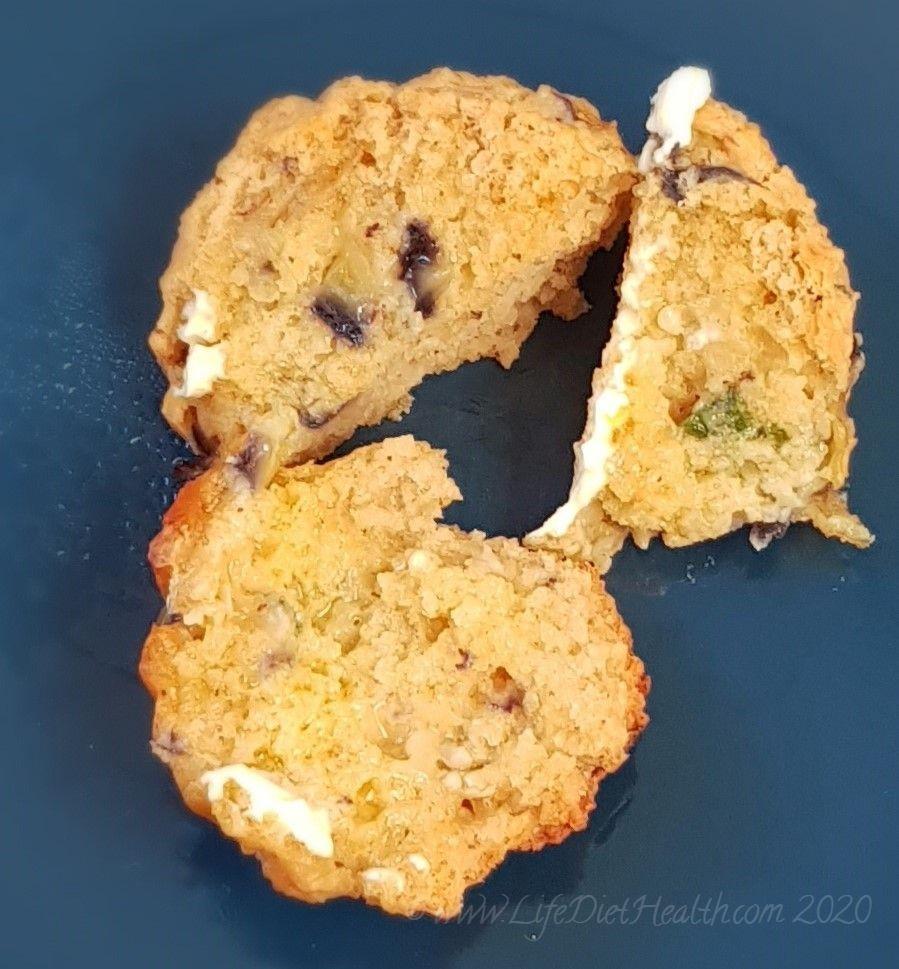 Split muffin on a navy blue sideplate