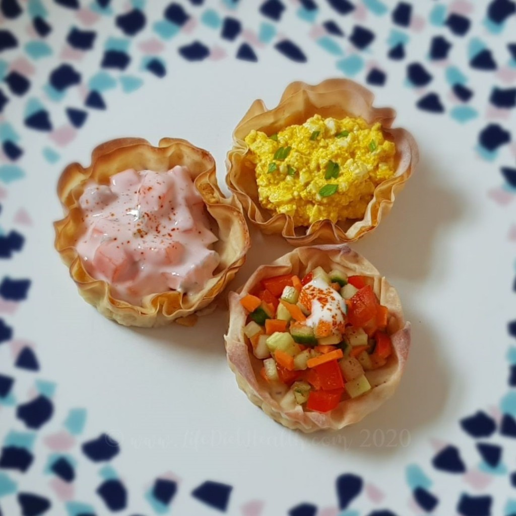 Plate showing three filled vol au vents (egg, prawn, salad)