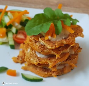 Stack of pumpkin pancakes with salad