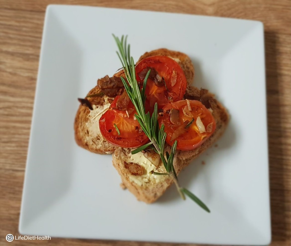 tomato toast on a white plate