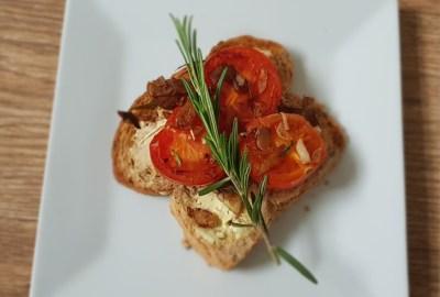 tomato toast on a white plate
