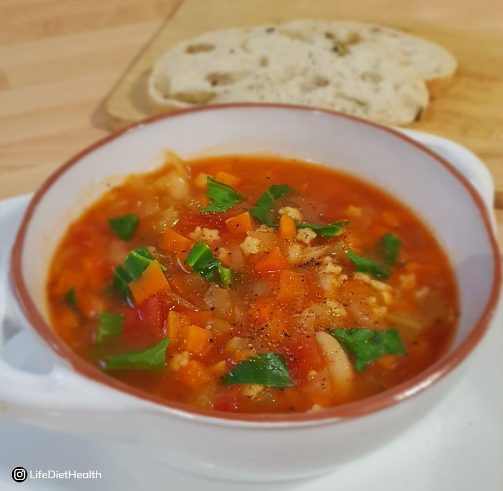 bowl of minestrone with bread