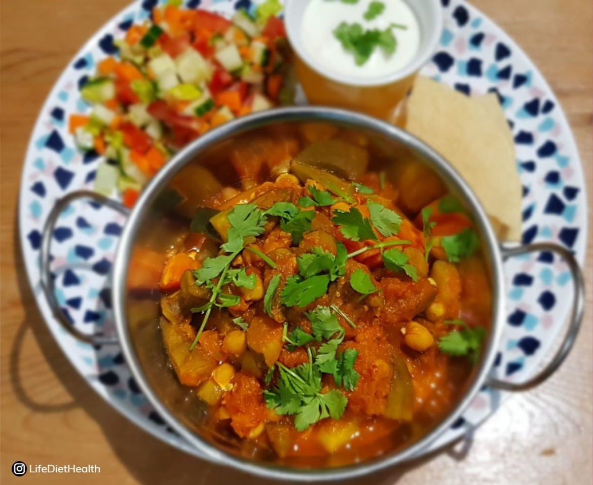 veg curry in silver dish