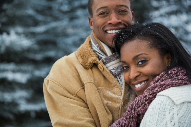 30 Nov 2012 --- Portrait of loving couple outdoors in winter --- Image by © Hero Images/Corbis