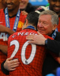 12 May 2013, Sir Alex Ferguson the head coach / manager of Manchester United hugs Robin Van Persie of Manchester United --- Image by © Matthew Ashton