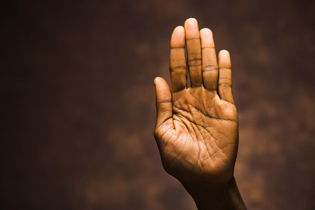 Hand Raised, Palm Out --- Image by © Tim McGuire/Corbis