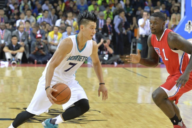NBA basketball star Jeremy Lin of Charlotte Hornets, left, challenges Chris Paul of Los Angeles Clippers in a match during the 2015 NBA China Games in Shenzhen city, south China's Guangdong province, --- Image by © Imaginechina/Corbis