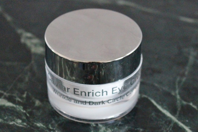 Kathleen Caviar Enrich Eye Cream picture showing outside of the tub, silver, mirrored lid and clean body with white writing.