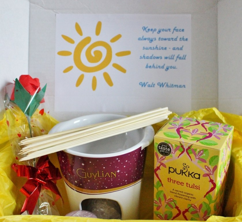 Pebblewise Sunshine Box inside of box with quote, paper rose, fondue set and tea